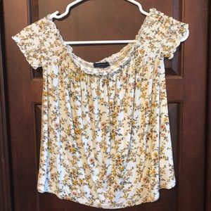 An American Eagle off the shoulder shirt.